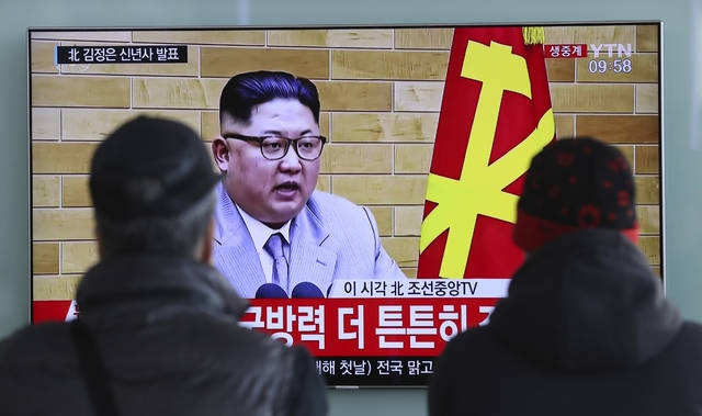 """South Koreans watch a TV news program showing North Korean leader Kim Jong Un's New Year's speech, at the Seoul Railway Station in Seoul, South Korea, Monday, Jan. 1, 2018. The letters read on top left, """"Kim Jong Un delivers New Year's speech.""""  Kim said Monday the United States should be aware that his country's nuclear forces are now a reality, not a threat. But he also struck a conciliatory tone in his New Year's address, wishing success for the Winter Olympics set to begin in the South in February and suggesting the North may send a delegation to participate.  (AP Photo/Lee Jin-man)"""
