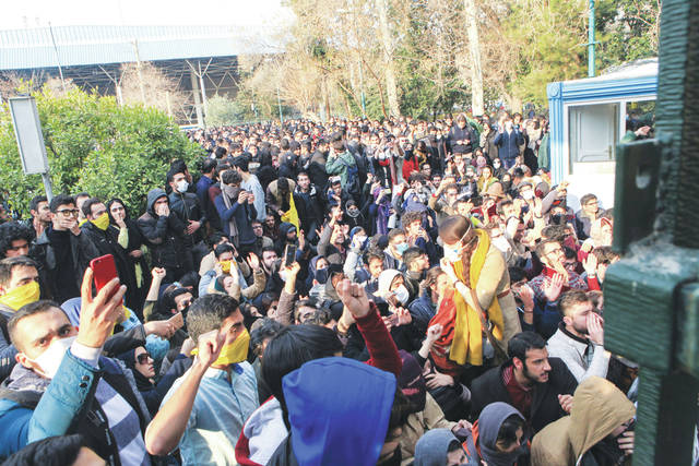 In this photo taken by an individual not employed by the Associated Press and obtained by the AP outside Iran, university students attend a protest inside Tehran University while anti-riot Iranian police prevent them to join other protestors, in Tehran, Iran.