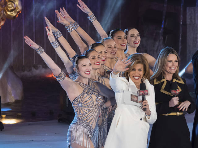 "FILE - In this Nov. 29, 2017, file photo, Savannah Guthrie, right, and Hoda Kotb appear with the Rockettes during the 85th annual Rockefeller Center Christmas Tree lighting ceremony in New York. NBC News opened the new year by appointing Kotb as co-anchor of the ""Today"" show's first two hours with Guthrie, replacing Matt Lauer following his firing on sexual misconduct charges in late November. (Photo by Charles Sykes/Invision/AP, File)"