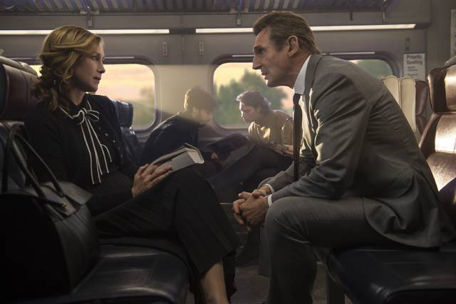 Vera Farmiga, left, and Liam Neeson act in a scene from 'The Commuter.' Neeson portrays an insurance salesman who, prompted by a mysterious stranger, must identify a hidden train passenger before the last stop.