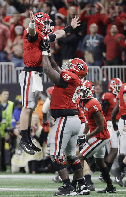 Freshman quarterback Jake Fromm, left, was the biggest surprise of Georgia's breakout season and is the biggest reason for the Bulldogs to hope for more success in 2018.