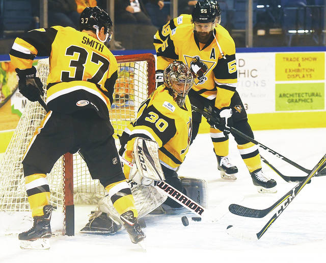 Wilkes-Barre Scranton Penguins players warm up against goalie Anthony  Peters before Friday   29e745175