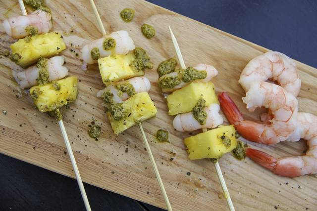 Shrimp and pineapple brochettes are healthy and versatile, working as either a meal when paired with some greens, a first course, or even an appetizer for parties.
