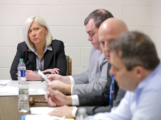 Newly appointed Laflin mayor Maureen Zavislak, left, listens to borough council during its reorganizational meeting at the borough building on Tuesday night.