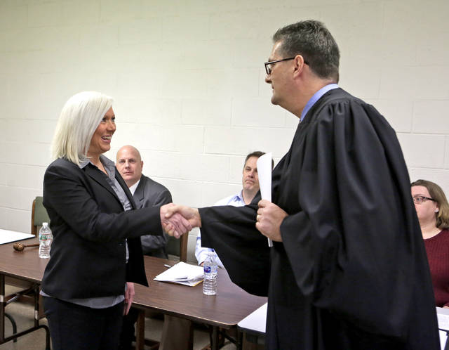 Maureen Zavislak is congratulated by Luzerne County Judge David Lupas after being sworn in as mayor of Laflin during the borough's reorganizational meeting Tuesday night.