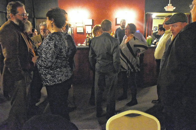 People socialize at the Music Box Dinner Playhouse in Swoyersville on Saturday evening as they await the arrival of recently retired director Michael Gallagher.