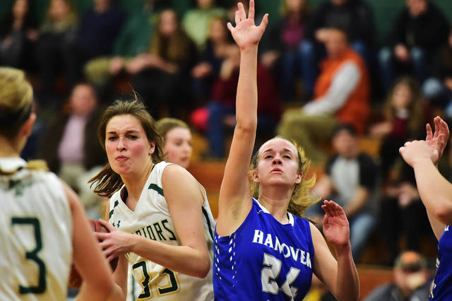 Hanover Area's Sara Whitesell, right, defends a pass going to Wyoming Area's Addison Orzel during Wednesday's game at Wyoming Area Secondary Center.