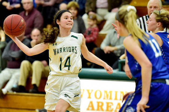 Wyoming Area's Sarah Holweg passes from half court to an open teammate during Wednesday's game against Hanover Area.