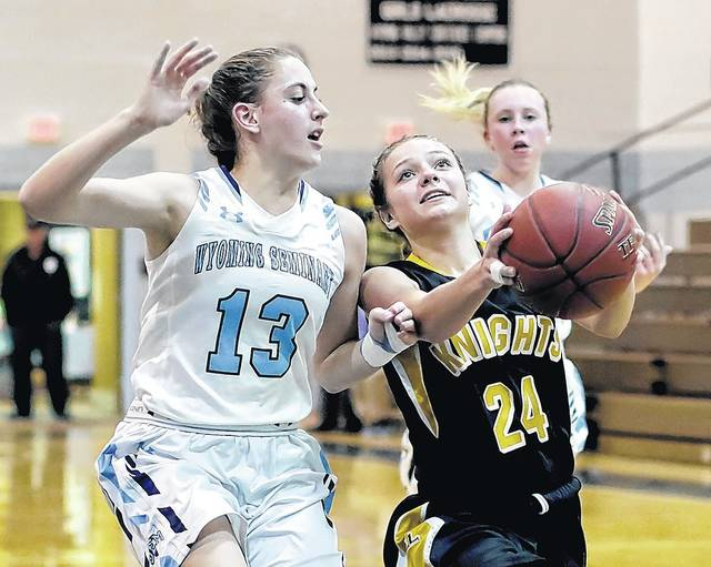 Lake-Lehman's Corinna Scoblick, right, drives to the hoop as Wyoming Seminary's Julia Gabriel defends in WVC girls basketball action Friday night in Kingston.