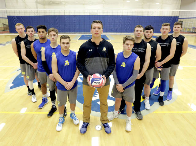 Misericordia head men's volleyball coach Robert Wingert, center, and the rest of the Cougars will play their first game on Jan. 19 against Neumann University at the Anderson Center.