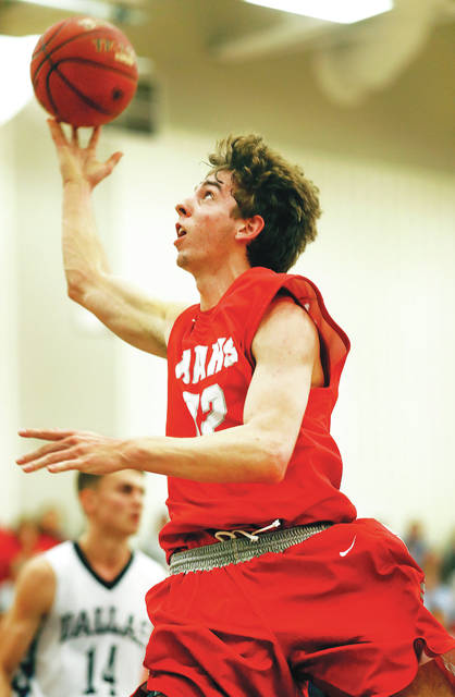 Hazleton Area's Jeff Planutis goes up for a basket against Dallas during the second quarter of Friday's game.