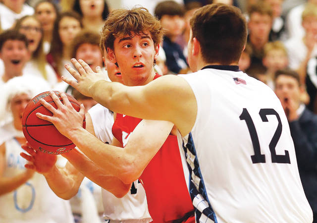 Hazleton Area's Jeff Planutis looks to pass the ball under tight defensive pressure by Brody Strickland of Dallas.