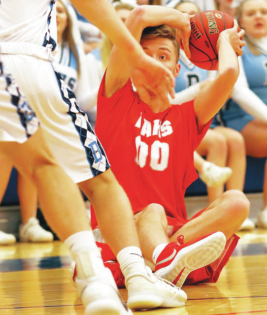 Hazleton Area's Josh Samec tries to pass the ball after falling to the floor.