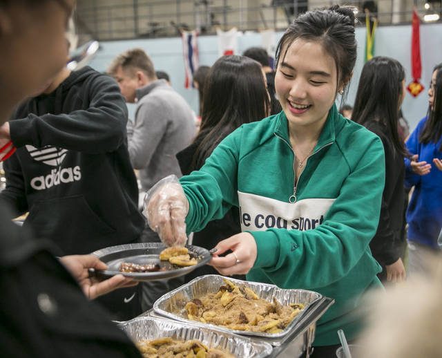 Wyoming Seminary senior Jennifer Kang, a student from South Korea, serves Korean pancakes.