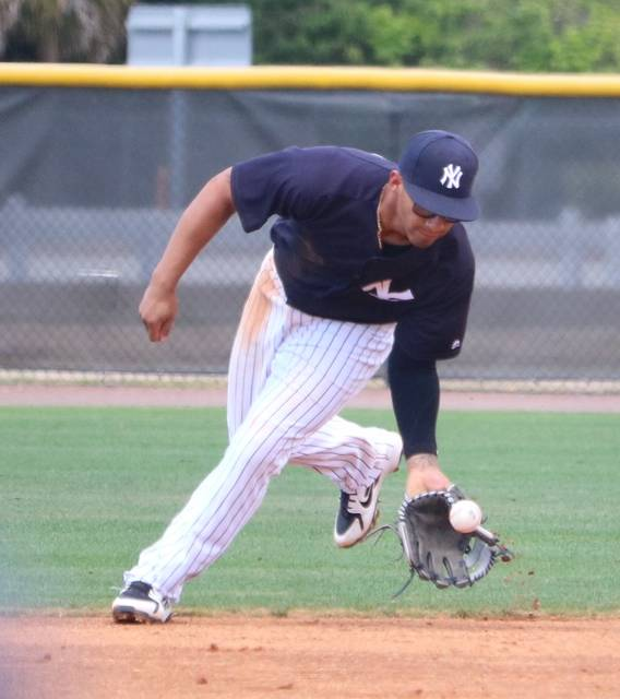 Scranton/Wilkes-Barre RailRiders infielder Gleyber Torres fields a groundball during Sunday's spring training game against the Buffalo Bisons at the New York Yankees minor league complex in Tampa, Fla.