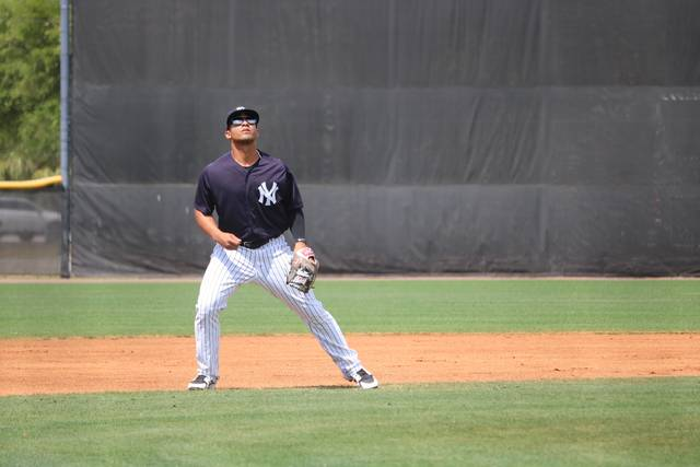 Scranton/Wilkes-Barre RailRiders infielder Gleyber Torres looks to field a pop fly during Sunday's spring training game against the Buffalo Bisons at the New York Yankees minor league complex in Tampa, Fla.