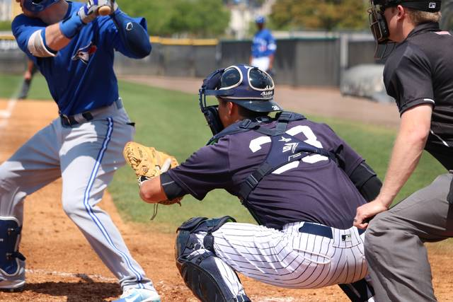 Scranton/Wilkes-Barre RailRiders catcher Kyle Higashioka prepares to receive a pitch during Sunday's spring training game against the Buffalo Bisons at the New York Yankees minor league complex in Tampa, Fla.