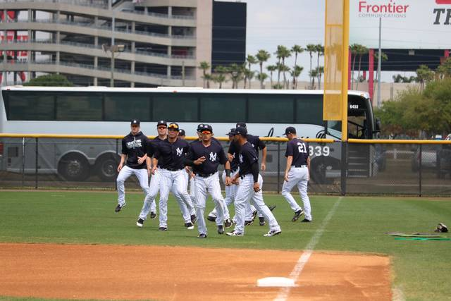 The Scranton/Wilkes-Barre RailRiders warm up prior to Sunday's spring training game against the Buffalo Bisons at the New York Yankees minor league complex in Tampa, Fla.