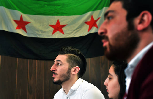 Syrian native Anas Allouz, 23, of Kingston, talks about adapting to life in America after immigrating in 2015 and living in Northeastern Pennsylvania after Donald Trump won the 2016 presidential election. Sitting beside him are younger sister Rama, 10, and older brother Bilal, 24.