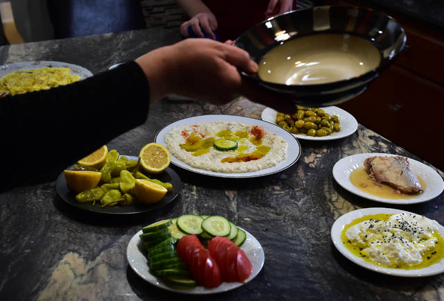 The Allouzes, native Syrians now living in Kingston, enjoy traditional Middle Eastern breakfast foods at their home.