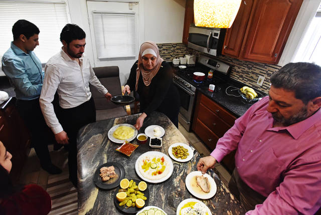 The Allouz family prepares a traditional Middle Eastern breakfast in the kitchen of their Kingston home on a recent Saturday.