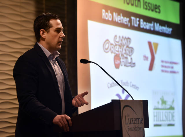 Rob Neher, a board member for the Luzerne Foundation, announces the next set of non-profits vying for grant money at a forum Thursday at the Holiday Inn Wilkes-Barre — East Mountain in Plains Township. Aimee Dilger   Times Leader
