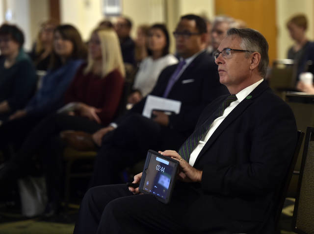Charles Barber, president and CEO of the Luzerne Foundation, holds a timer Thursday while one of 33 non-profit organizations presents its five-minute case to recieve grant money. Grant recipients will be announced May 10. Aimee Dilger   Times Leader