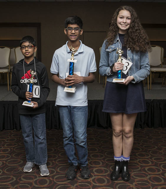 Pitured are the top three finishes in the Times Leader/Scripps Spelling Bee. From left, Aditya Panikkath, second place; Abhinav Palle, winner; and Jessie Miller, third place.