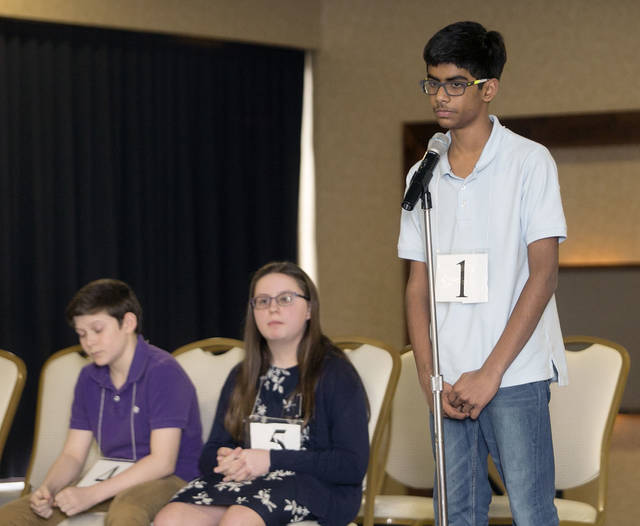 Ben Carsell and Alyssa Evans wait their turn while Abhinav Palle of Abington Heights Middle School spells a word at the 2018 Times Leader/Scripps Spelling Bee at the Woodlands Inn in Plains Township on Sunday.