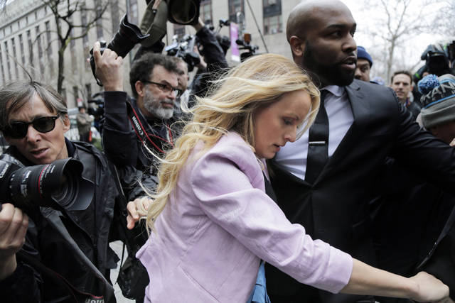 Stormy Daniels arrives at federal court in New York on Monday to attend a court hearing where a federal judge is considering how to review materials that the FBI seized from President Donald Trump's personal lawyer to determine whether they should be protected by attorney-client privilege.