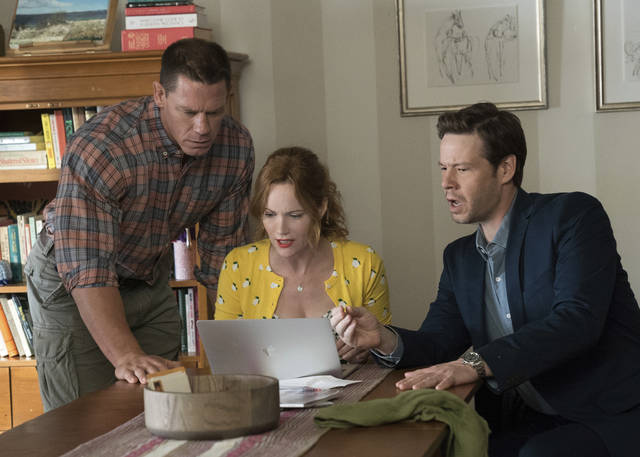 This image released by Universal Pictures shows John Cena, from left, Leslie Mann and Ike Barinholtz in a scene from 'Blockers.'