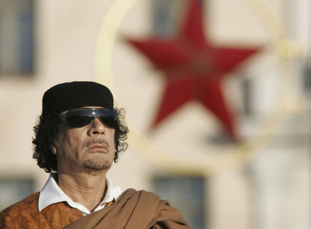 """On this date in 1986, dispelling rumors he was dead, Libyan leader Moammar Gadhafi (MOO'-ah-mar gah-DAH'-fee) appeared on television to condemn the U.S. raid on his country and to say that Libyans were """"ready to die"""" defending their nation."""