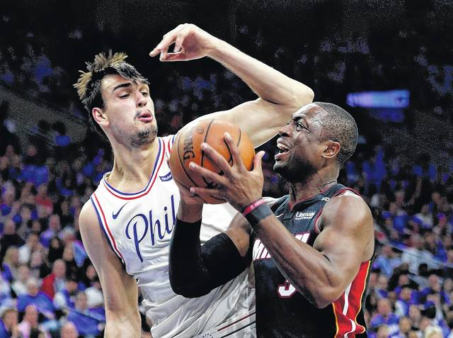 Miami Heat's Dwyane Wade, right, makes a move against Philadelphia 76ers' Dario Saric during the first half in Game 1 of Saturday's first-round NBA playoff game in Philadelphia.