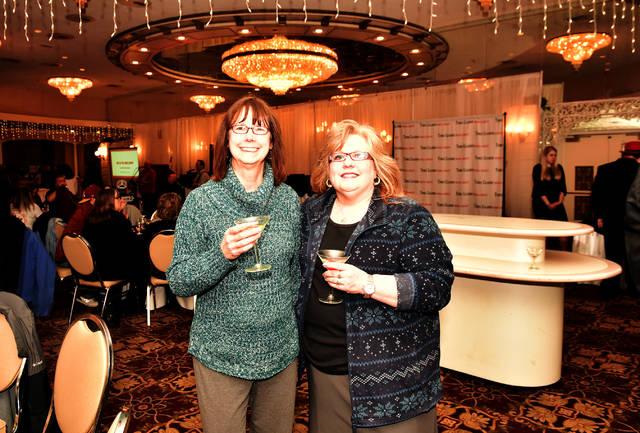 Rita Kaminski and Lynn Humanik, of St. Nicholas Church in Wilkes-Barre, enjoy the banquet. The church's bazaar won for best local bazaar.