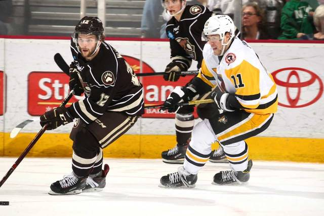 Daniel Sprong chases Hershey's Nathan Walker during Sunday's game at the Giant Center. Sprong needed a hat trick to win the AHL goal scoring title, but scored one time in the game.