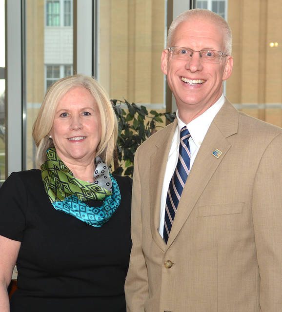 Lynn Evans Biga, of Luzerne County Head Start, and Bill Jones, of the United Way of Wyoming Valley, were honored during the 'Dinners For Kids' celebration Wednesday at Misercorida University's Insalaco Hall in Dallas Township. Biga received the group's Kids Hero Award, and Jones and the United Way picked up the Community Service Award.