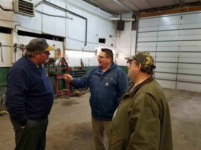 Norb Dotzel, of Dotzel Trucking & Topsoil in Slocum Township, discusses his business needs with state Rep. Gerald Mullery, D-Newport Township, and Slocum Township Supervisor Charles Herring.