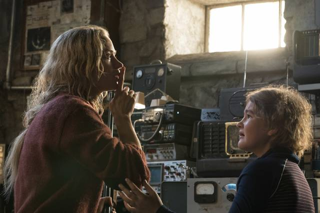 This image released by Paramount Pictures shows Emily Blunt playing Evelyn Abbott and Millicent Simmonds playing Regan Abbott on the set of 'A Quiet Place.'