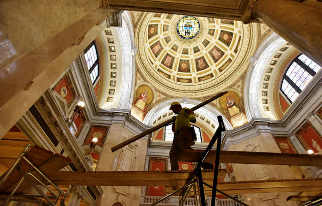 In this February photo, a worker helps tear down the scaffolding leading up to the rotunda of the Luzerne County Courthouse.