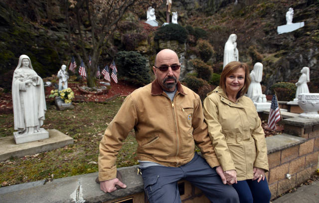 Leo and Sharon Ellis, of Hanover Township, spend some quiet moments in the Fatima Grotto maintained by the Lay Servants of the Immaculate Heart of Mary on North Street in Wilkes-Barre. Leo Ellis is an officer of the group and plans to install a statue of St. Dymphna, patron saint of those suffering from mental disorders, there this summer.