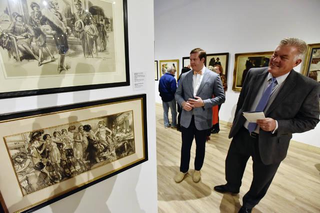 Steve Hudacek, right, of Scranton, and his son Steve, of Harveys Lake look at the exhibit at the Sordoni Art Gallery in Wilkes-Barre. 4/7/18. Sean McKeag   Times Leader