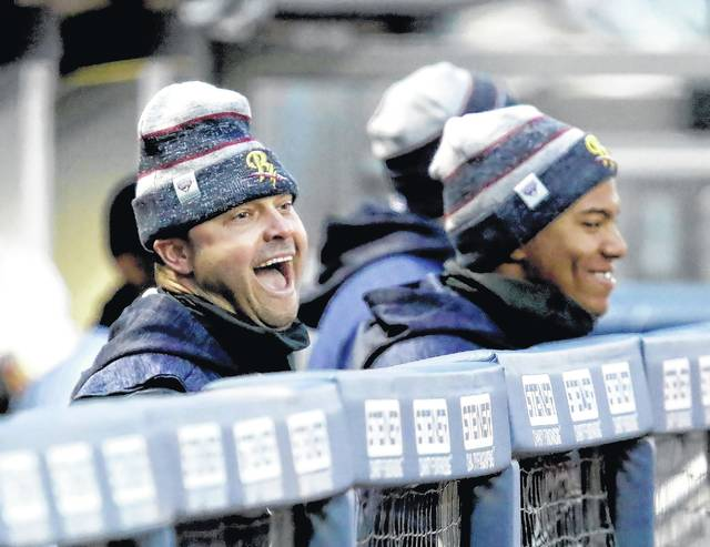New York Yankees special adviser Nick Swisher, left, shares a laugh in the Scranton/Wilkes-Barre RailRiders dugout during Monday's game against Lehigh Valley.