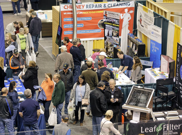 Show goers walk among the vendors on the floor of Mohegan Sun Arena on the final day of the Home and Garden Show on Sunday.