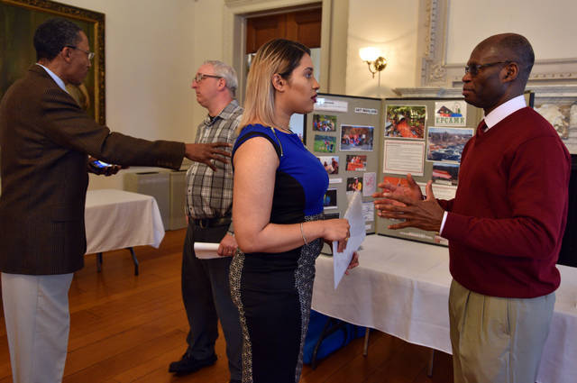 Shawnese Taylor of Kingston speaks with Frank Derby of the GIS Program at a career fair following the Earth Conservancy's Environmental Workforce Training program at Penn State Wilkes-Barre in Lehman Township.