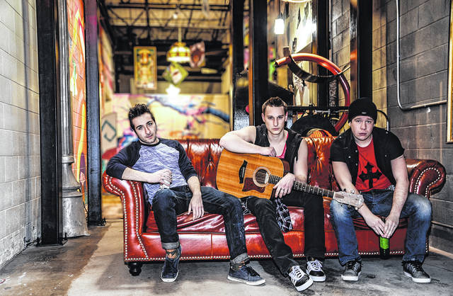 From left, Karl Kleist, Adam Zawatsky and Benjamin Steltz portray Will, Johnny and Tunny in 'American Idiot.'