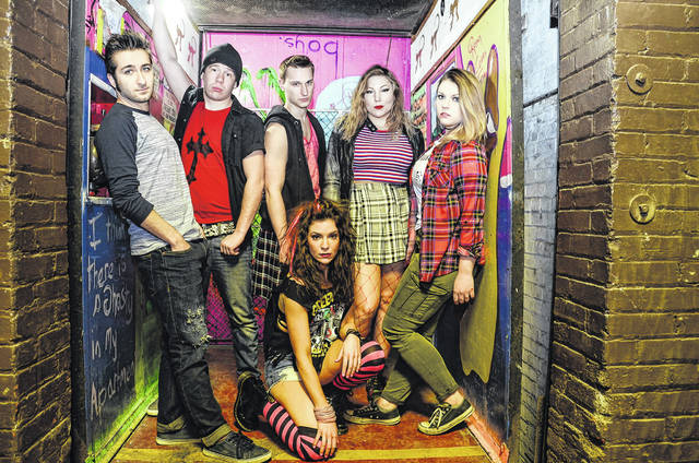 Cast members of 'American Idiot' include Shana Messinger as Whatshername, kneeling, and, standing, from left: Karl Kleist as Will, Benjamin Steltz as Tunny, Adam Zawatsky as Johnny, Ashlee Danko as Extraordinary Girl and Ericka Law as Heather.