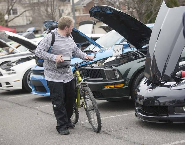 David Eisenbach, of Wilkes-Barre, checks out different cars during the 12th annual car show held by Wilkes University's branch of the American Society of Mechanical Engineers on Sunday.