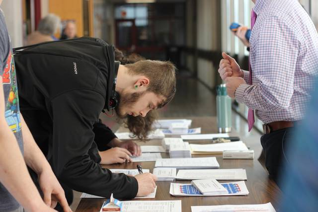 A Wyoming Valley West High School student registers to vote during a recent drive that attracted 87 percent of eligible students.