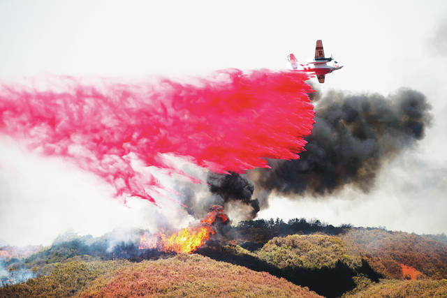 low priced cfc37 9b134 An air tanker drops retardant on a wildfire burning near Lakeport, Calif.,  on Monda. A pair of wildfires that prompted evacuation orders for thousands  of ...