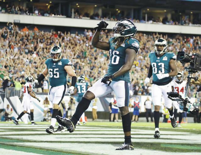 3729c7f171d Eagles running back Jay Ajayi celebrates scoring the game's first  touchdown in